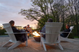 Gathered around the firepit as the sun sets