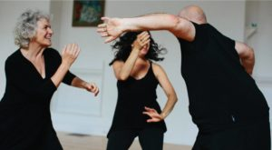 three adults dancing