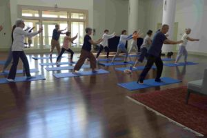 A group of people practice QiGong