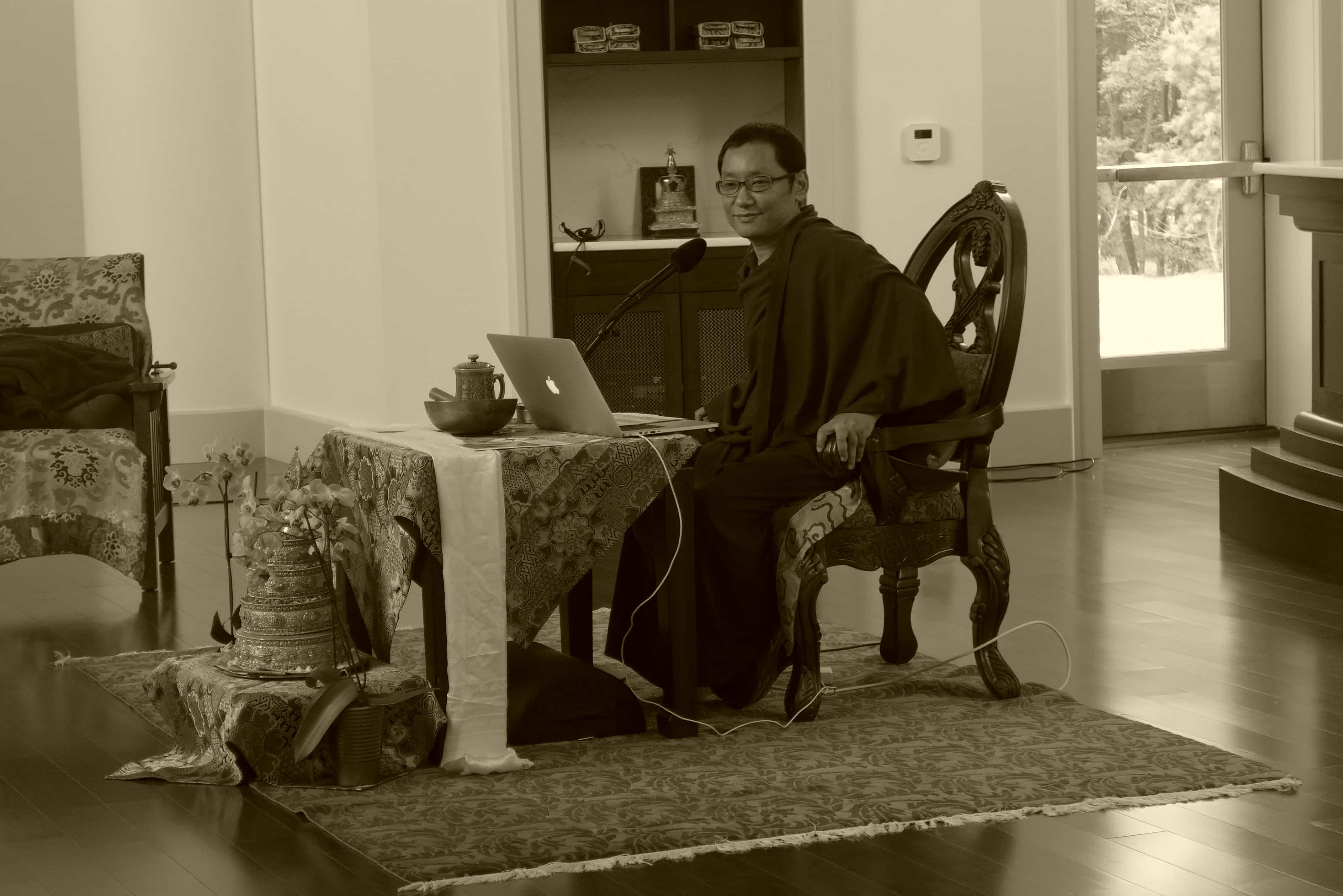 Black and White picture of seated Tibetan monk