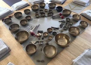 Tibetan singing bowls on a mat