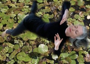 Elaine Colandrea superimposed over water lillies