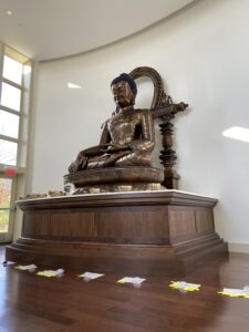 the magestic Buddha with offerings